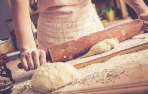 Image of person making bread